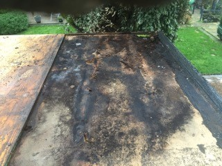 Damaged flat roof repairs Kent